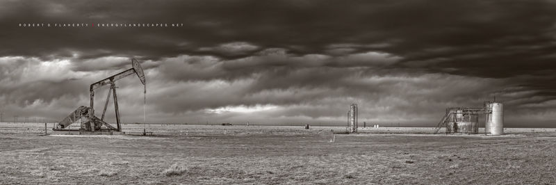 pumpjack, pump jack, pumping unit, cold front, arctic front, New Mexico, Chavez County, March, sepia