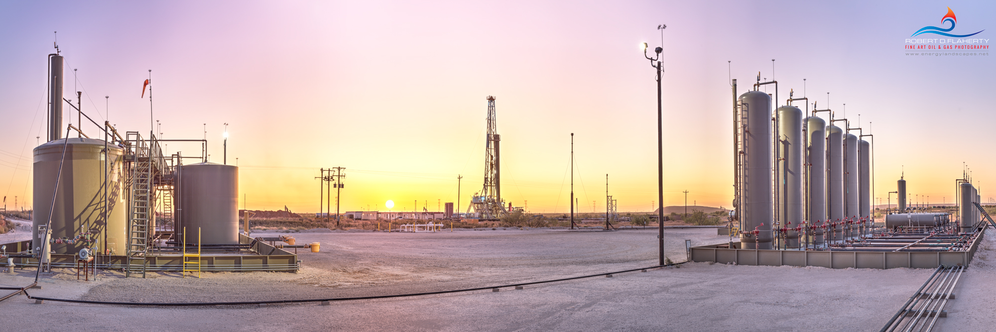 Let The Day Begin features a separator complex and battery along with Latshaw rig 11 at sunrise in the Eastern Midland Basin....
