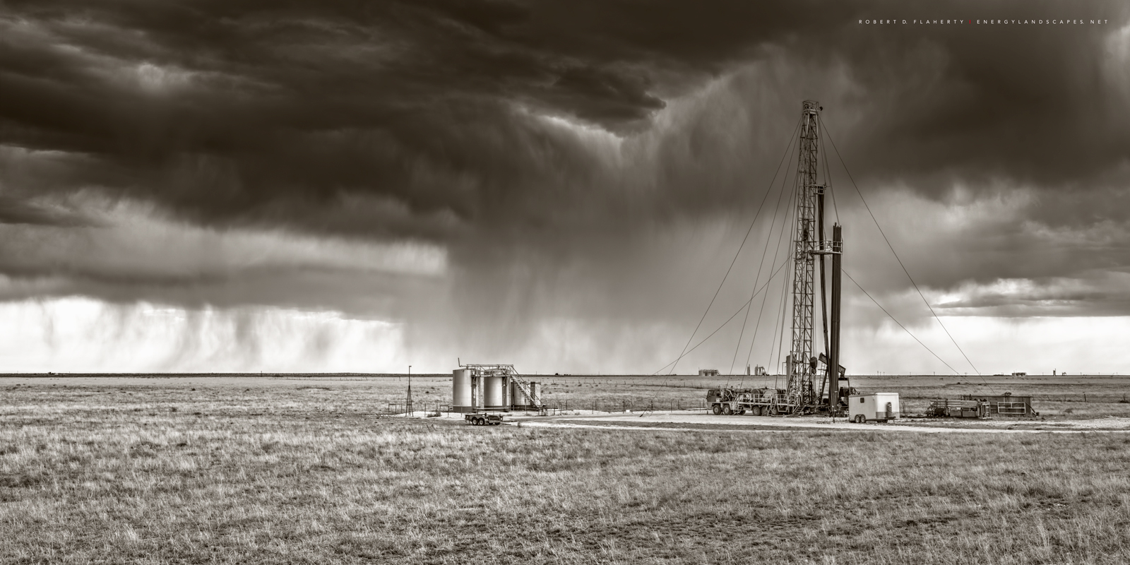 well services unit, work over rig, New Mexico, clouds, sky, black & white, sepia