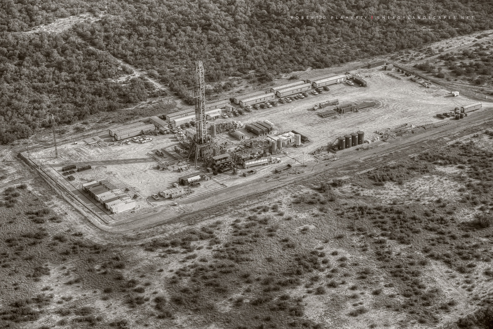 aerial photography, aerial oil & gas photography, aerial oilfield art, H&P Drilling, pad drilling, directional well, directional drilling, Eagle Ford, Texas, Kenyon Gyro, drilling rig, sepia, black & , photo