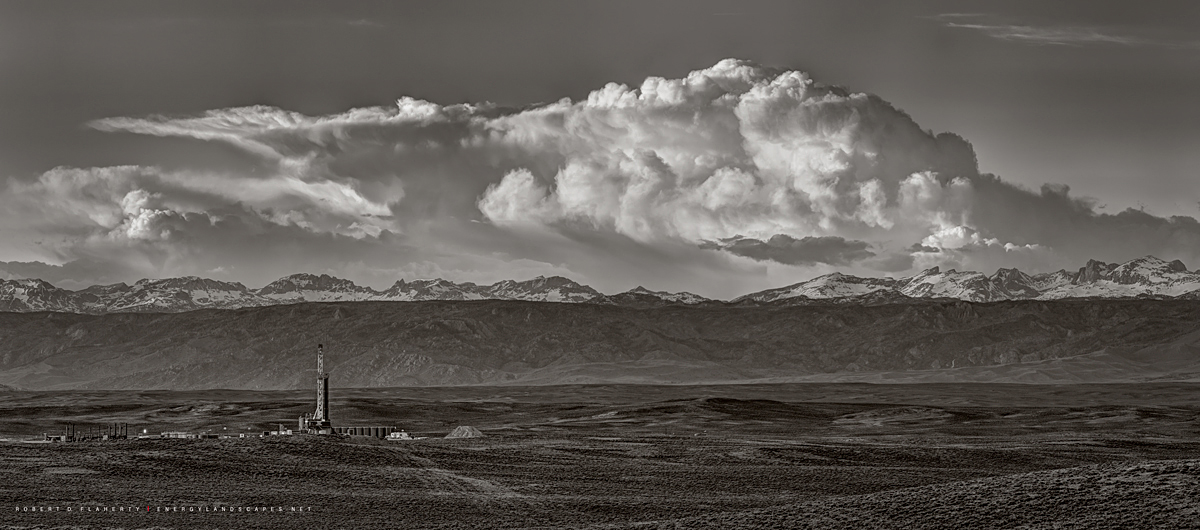 A Patterson drilling rig set alone against the Wind River Mountain range and a late spring storm in early June 2014. Please call...